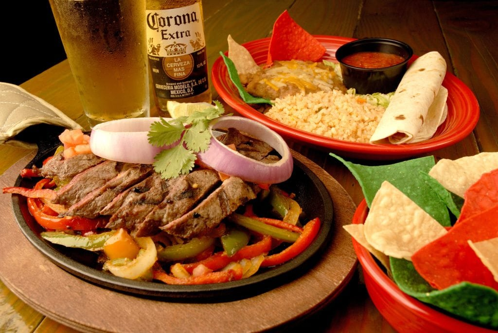 Steak Fajitas with rice and beans. Tortilla chips and Corona beer